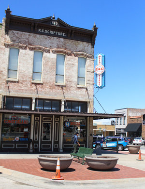 a picture of the outside of coney island during the day on the downtown denton square