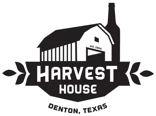 a black and white harvest house denton texas logo with a barn and some leaves