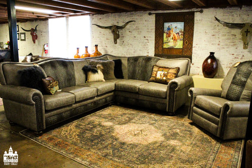a picture of three brown leather couches inside Cowhide Custom Furniture Co Store