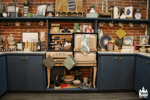 a picture of the inside of a store front with a vintage stove in it.