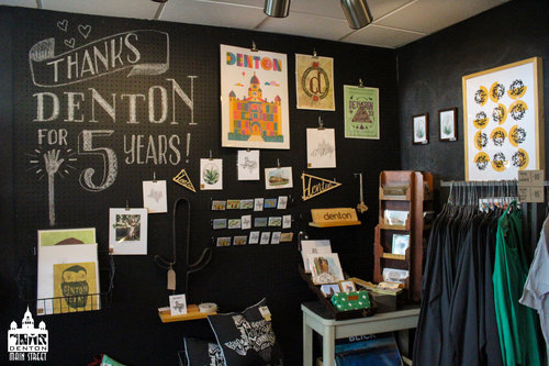 a picture of the inside of a store with prints and related products on the shelves. .jpg
