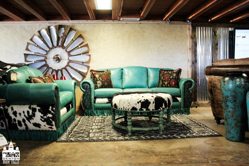 a store room with a living room set of furniture made in teal leather and cow skin.