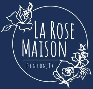 "a blue background with a white logo that reads ""la rose maison denton,tx"""
