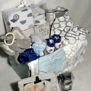 a basket of white and blue gifts sitting against a white background.