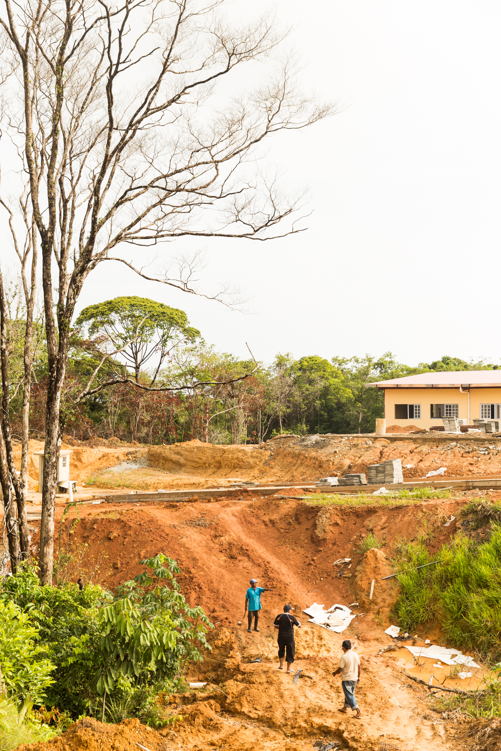 """The construction site at the """"Nueva Barria""""- the new community being built on the mainland near Gardi Subdub. The new school building is projected to open this year, with construction of the residential community to be built next. The Panamanian government began construction of a new health center, but the building has been sitting unfinished for years."""