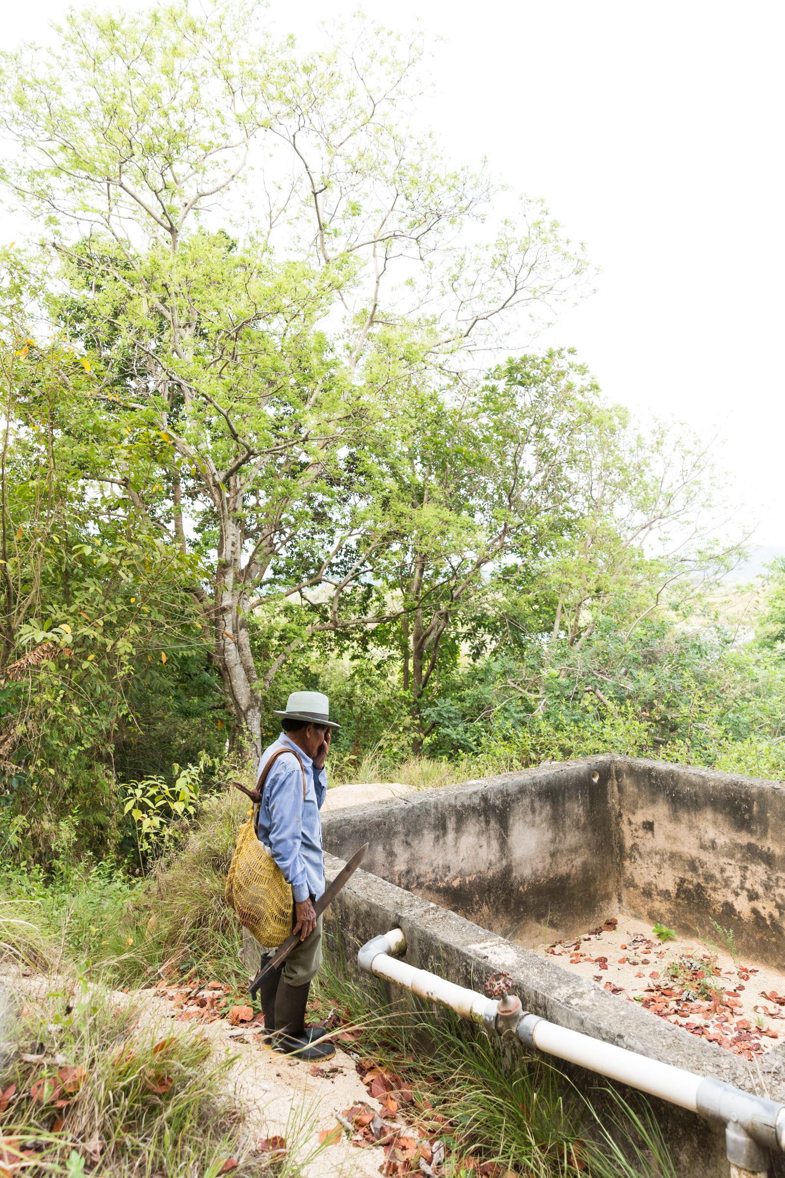 Saila Leonidas Perez by a dry water reservoir on the mainland near the Coetupu community.