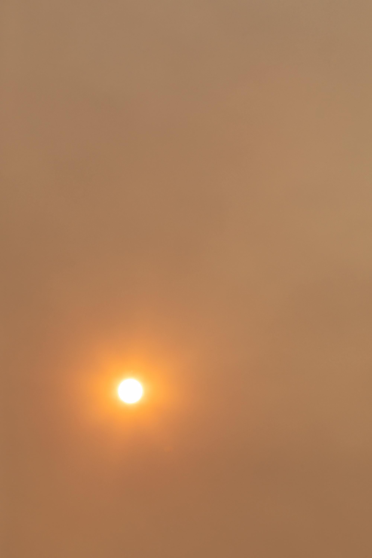 Smoke, sun, and sky. 11:58am. Boise, Idaho.