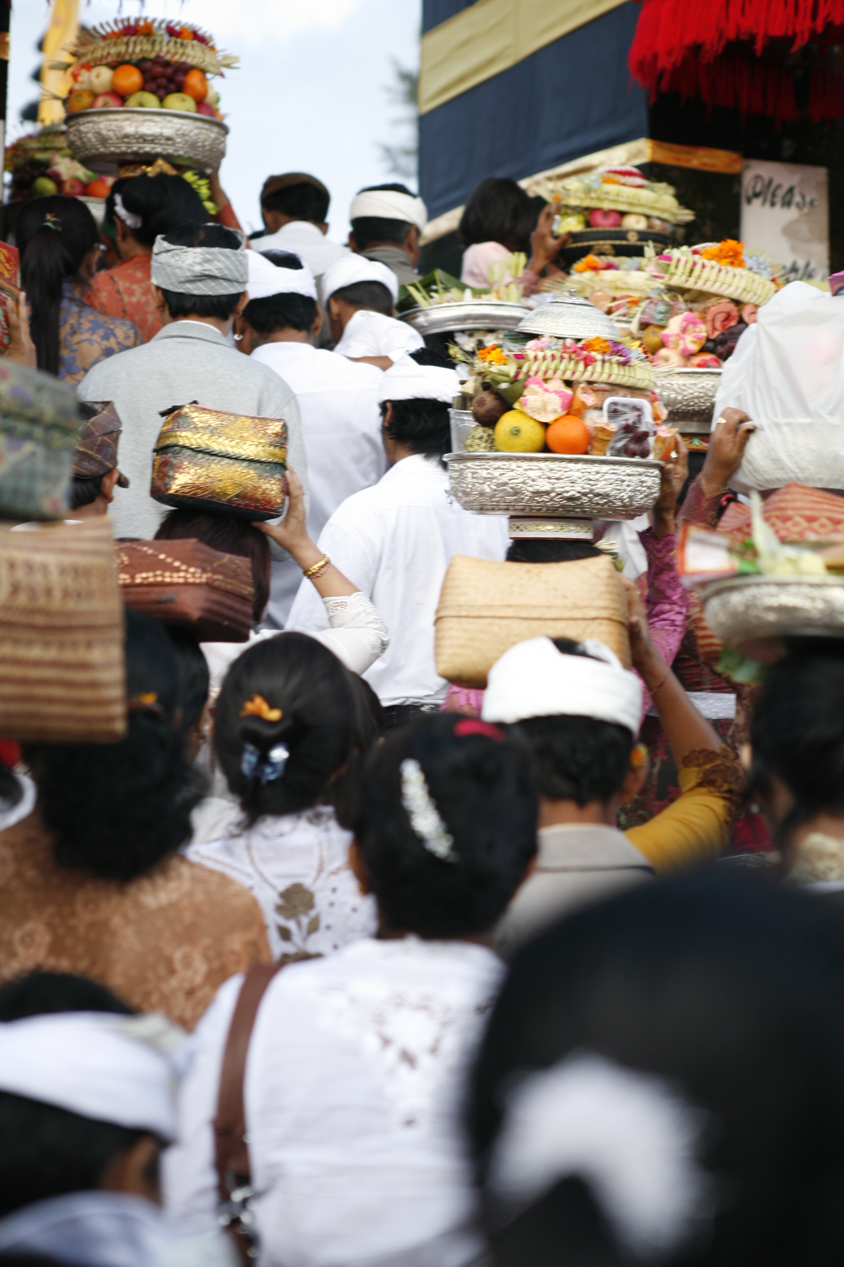 Locals making their way to bring offerings to the temple