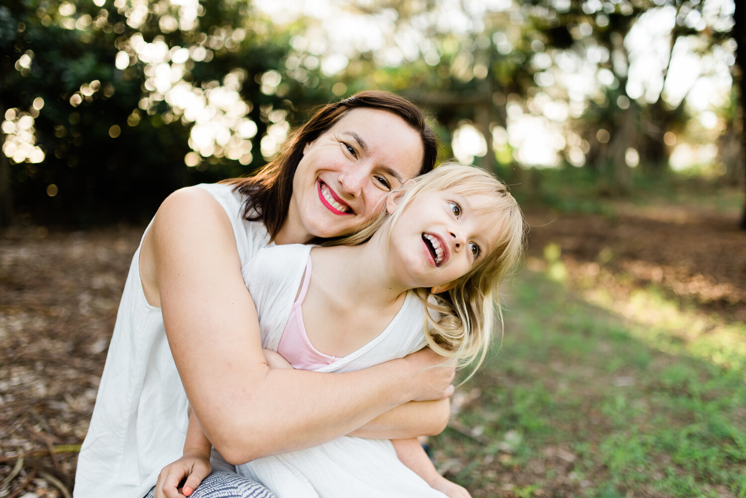 Janelle and her mini me having a wriggly hug during their family session at the beach in Caloundra on the Sunshine Coast.