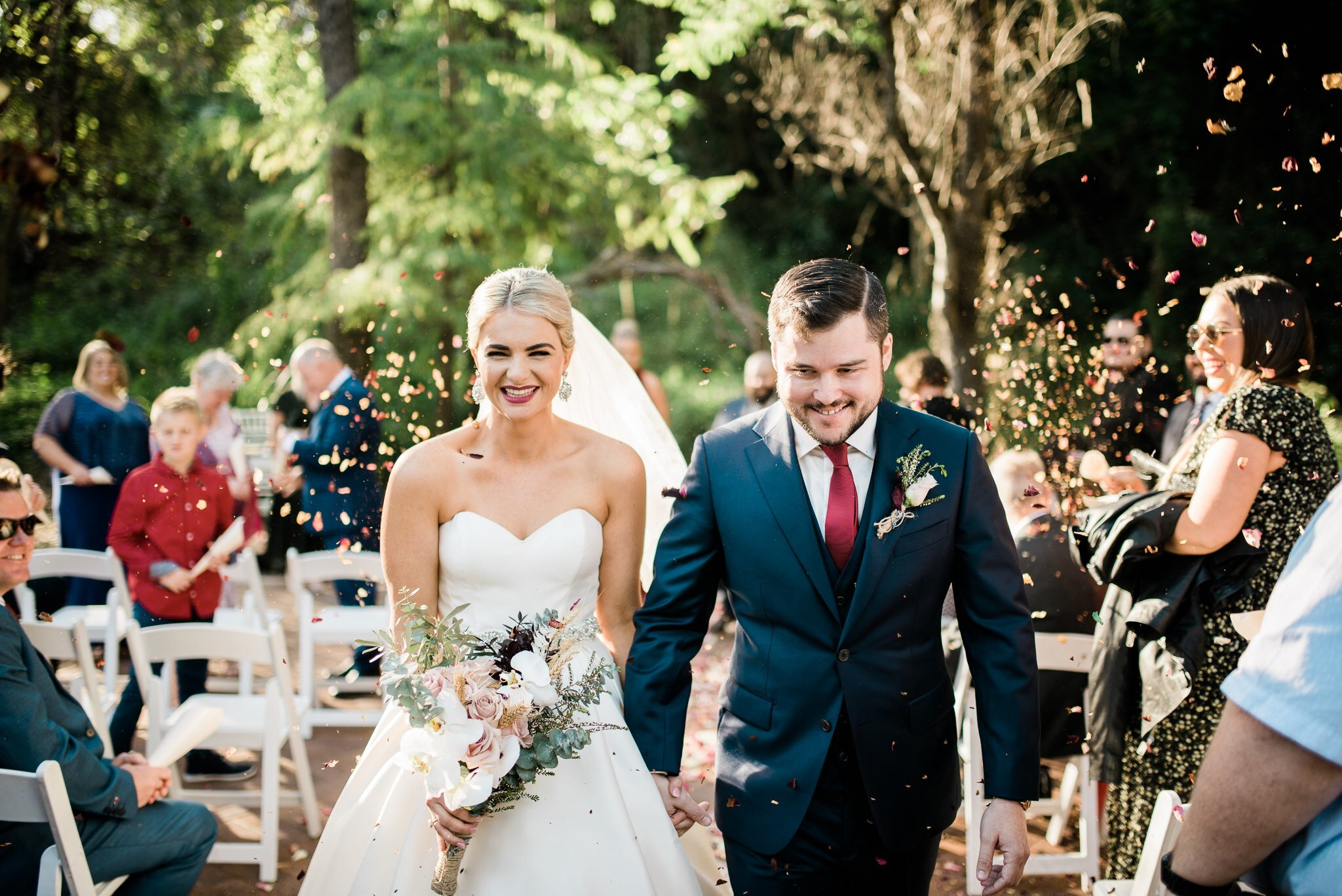 Bonnie and Tom, blissed out after their wedding ceremony at  Bundaleer Rainforest Gardens .