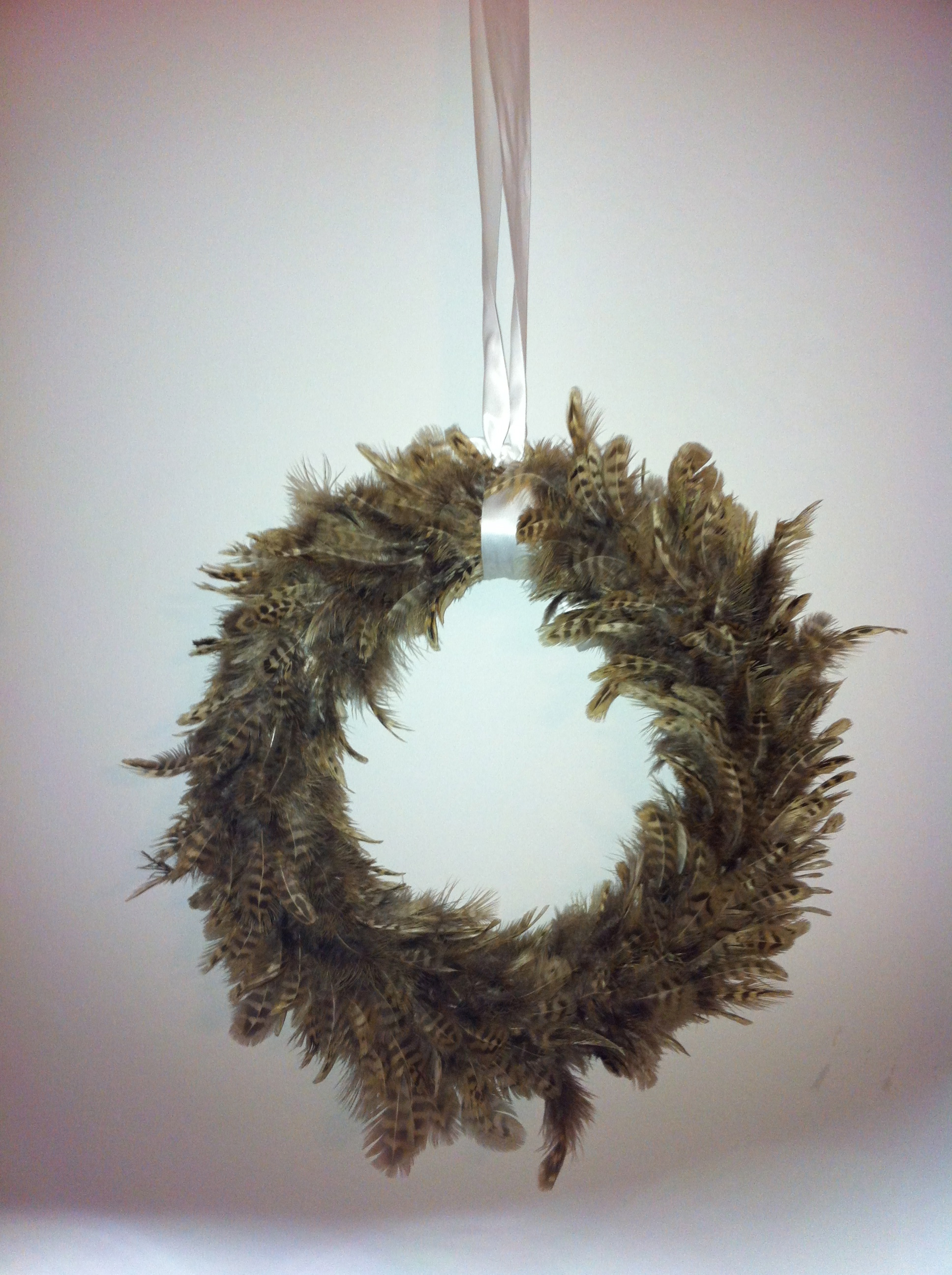Handmade feathered wreath £10