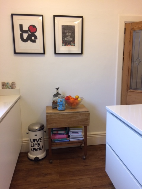 This is the dividing wall between the hall and the kitchen that I wanted knocking out. Now it's a great place for pictures and I love that I can put a vintage trolley table with all my colourful and no-longer ornamental cook books there. This one was £5 from a charity shop.