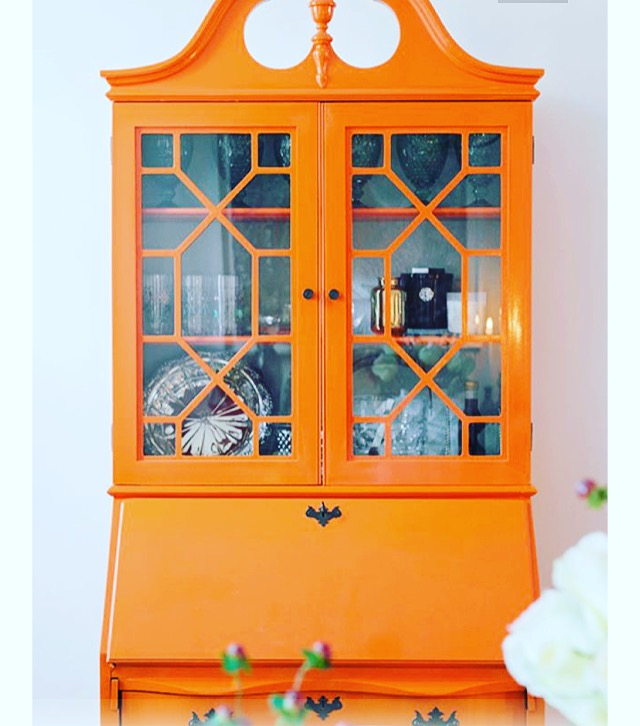 Painted orange display cabinet. Image from Pinterest.