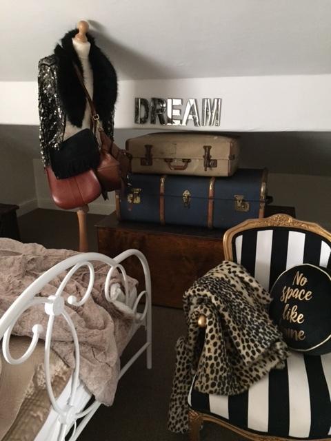 Vintage trunks make great guest room storage