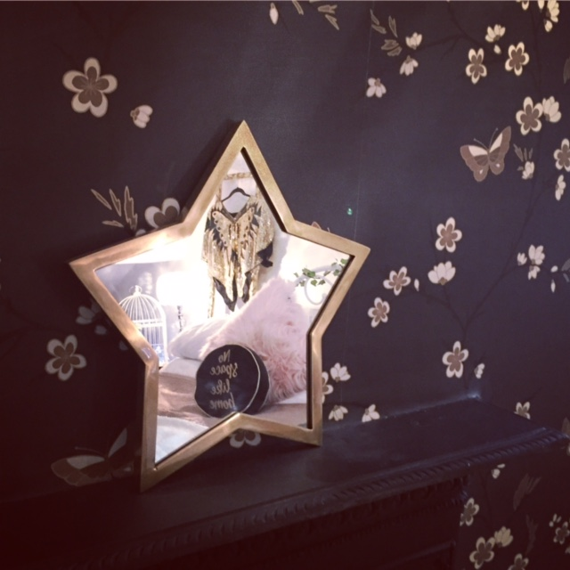 Brass star mirror £80 by  Cox and Cox