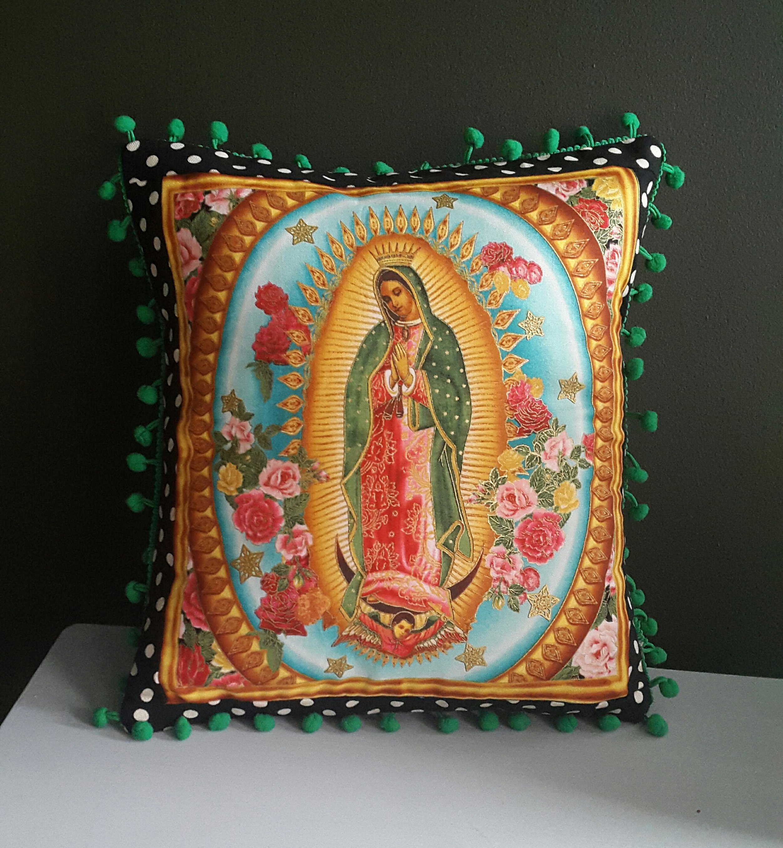 The popular Our Lady of Guadaloupe cushion available on  Etsy