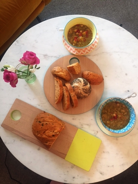 Colourfully edged serving platters are perfect for displaying rustic breads.