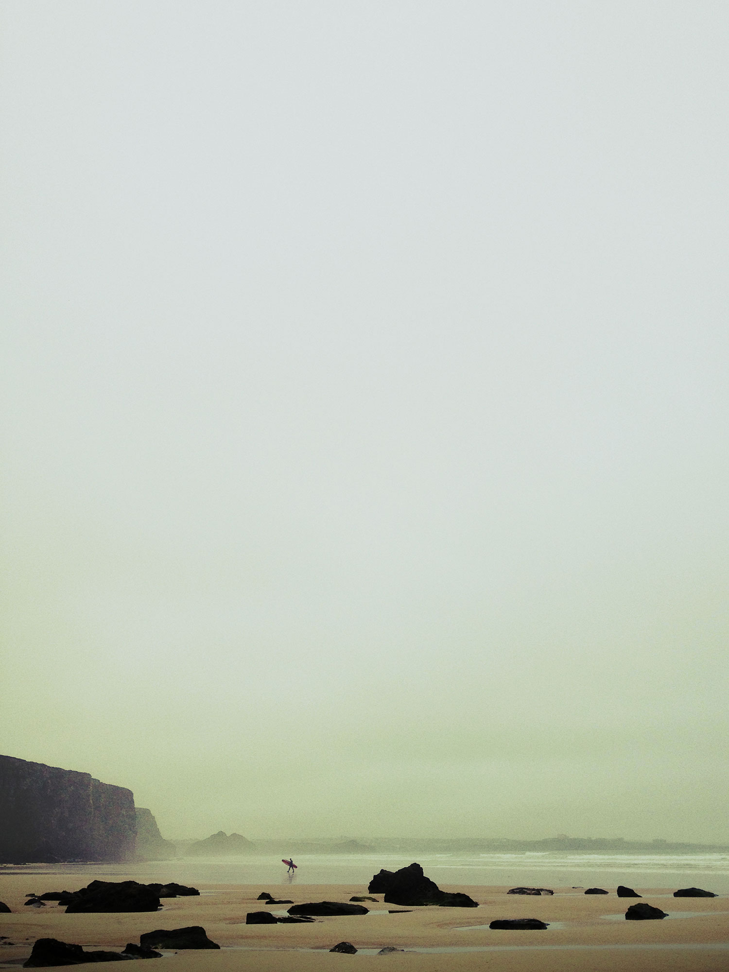 surfer-sand-cliffs-mist.jpg