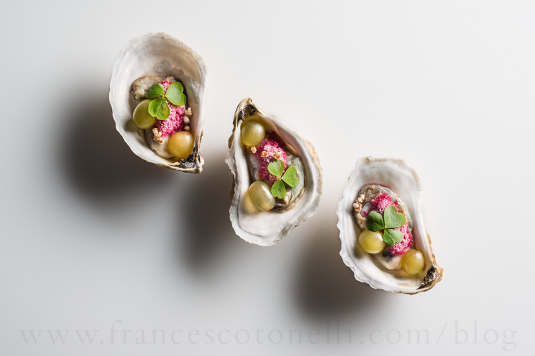 Oysters with grapes and snow