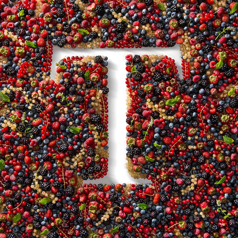 Mixed Fresh Berries arranged in order to form the shape of the Tonelli T logo.