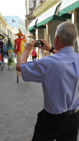 Abraham taking pictures of street performers in Old Havana