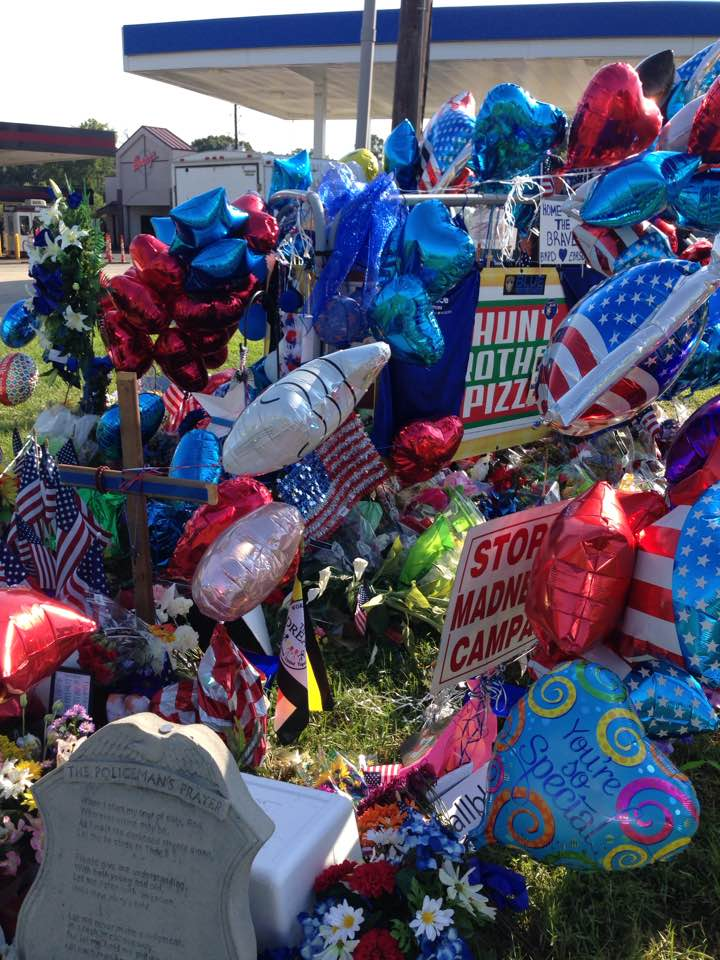 The memorial to two slain Baton Rouge police officers and an East Baton Rouge Sheriffs deputy sits less than a block from the Louisiana Farm Bureau Federation's office in Baton Rouge.