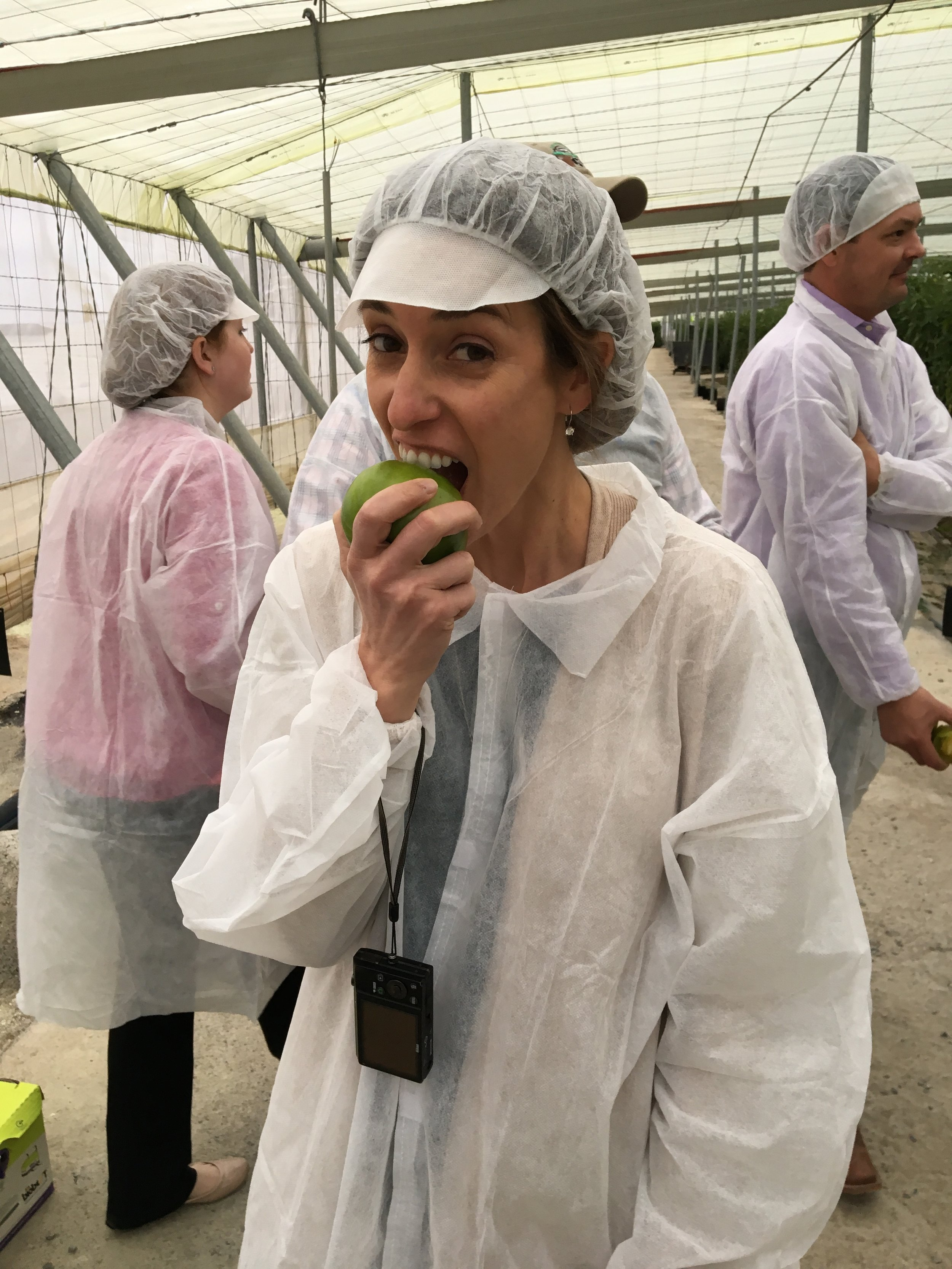 Laura Barham, Brian's wife, couldn't help but take a bite out this fresh green tomato.