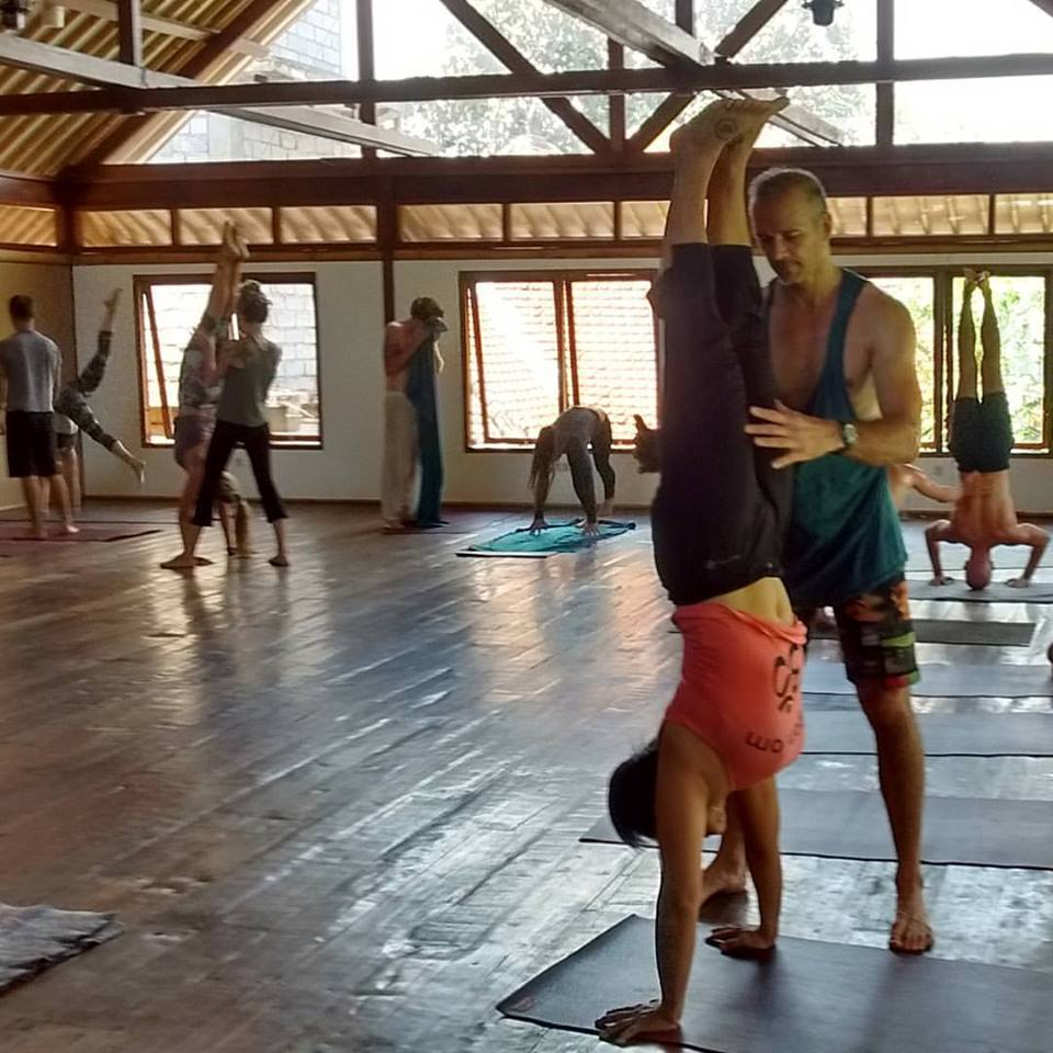 Hang practicing her handstand in an arm balancing class at Radiantly Alive Yoga Studio in Ubud, Bali.