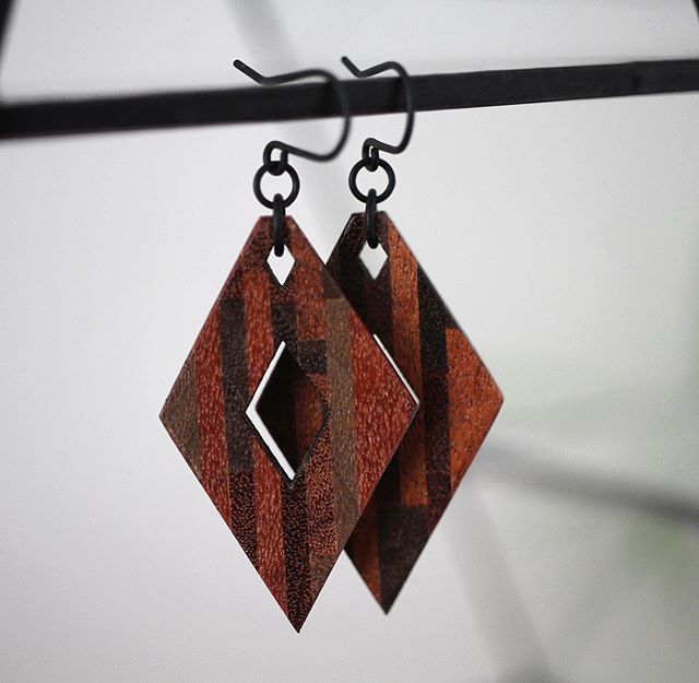 Rhombus dangle earrings made from mixed repurposed hardwoods - just added these to @adrianmartinus shop and on our #etsy / These are also included in the long weekend sale!  #jewelry #design #dangleearrings #wood #woodjewelry #madeincanada #geometric #yyc #yycdesign #yycarts #etsy #etsyshop #etsycanada #instadesign #instaart