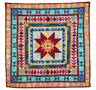 Traditional medallion quilt made with original pattern and modern fabrics.