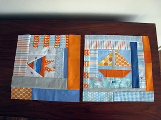 Log-cabin style nautical-themed blocks for a baby quilt.