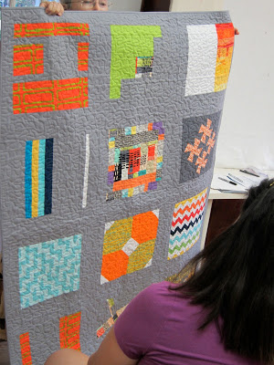 Here is one more view of the completed charity quilt for Project Linus, using QuiltCon colors.  Thanks to everyone who created this beautiful quilt for a good cause!  We also discussed the amazing Charity Sewing Day we held in May for Project Linus, and 20 quilts were made for children in need!