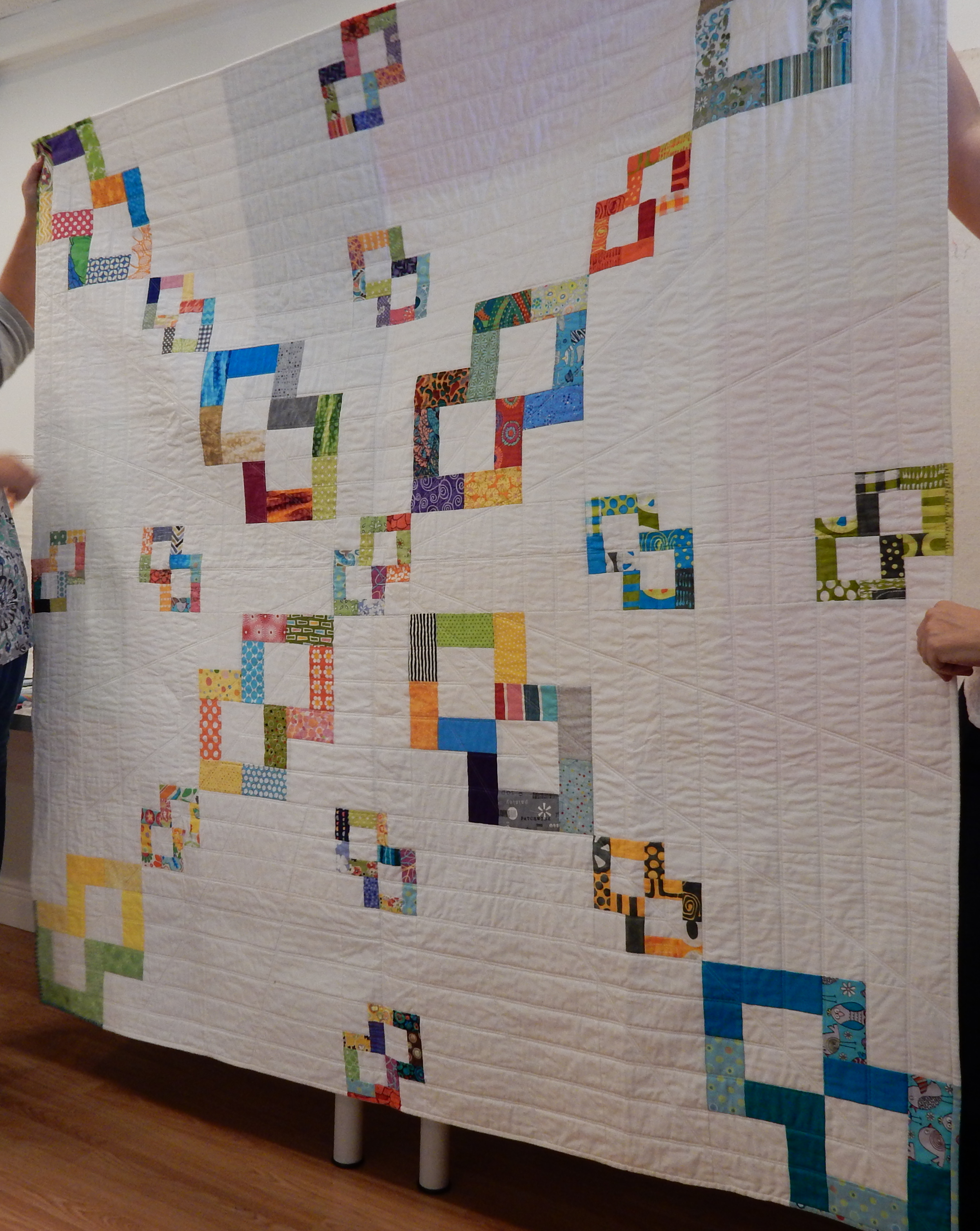 Charlotte Noll showed an example of a modern quilt with negative space, using her SFMQG bee blocks.