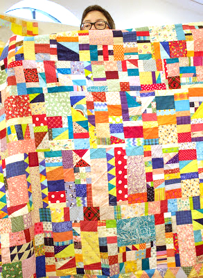 Tonya with one of her quilts at our July meeting.