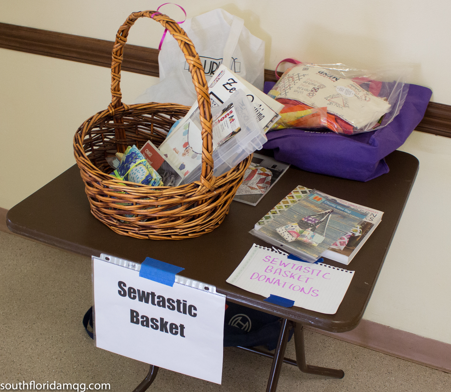 Gathering up donations for the Sewtastic Raffle basket fundraiser for June meeting