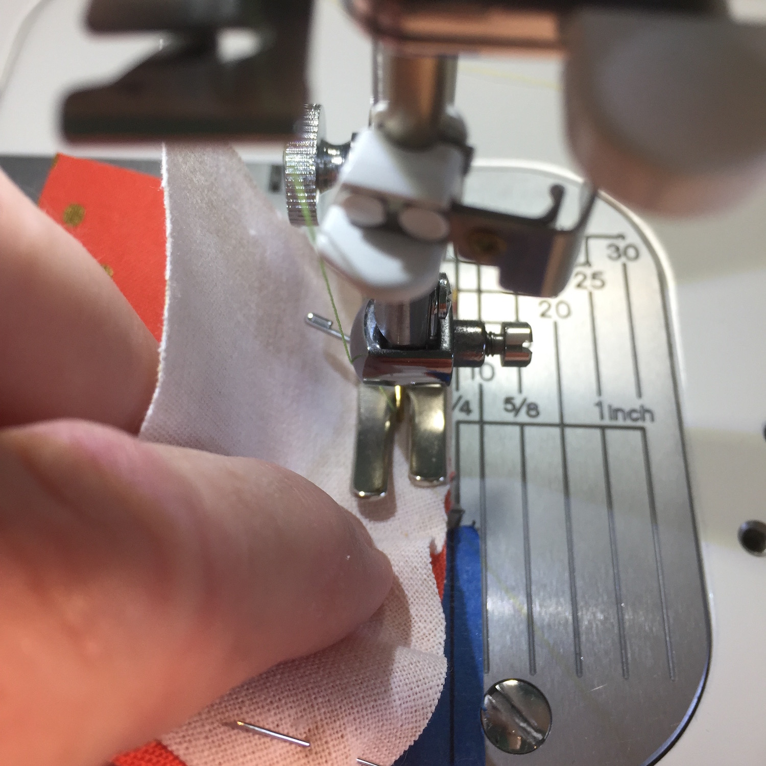 With the needle down you may have to lift the presser foot and adjust the fabric to keep it even and at ¼ inch