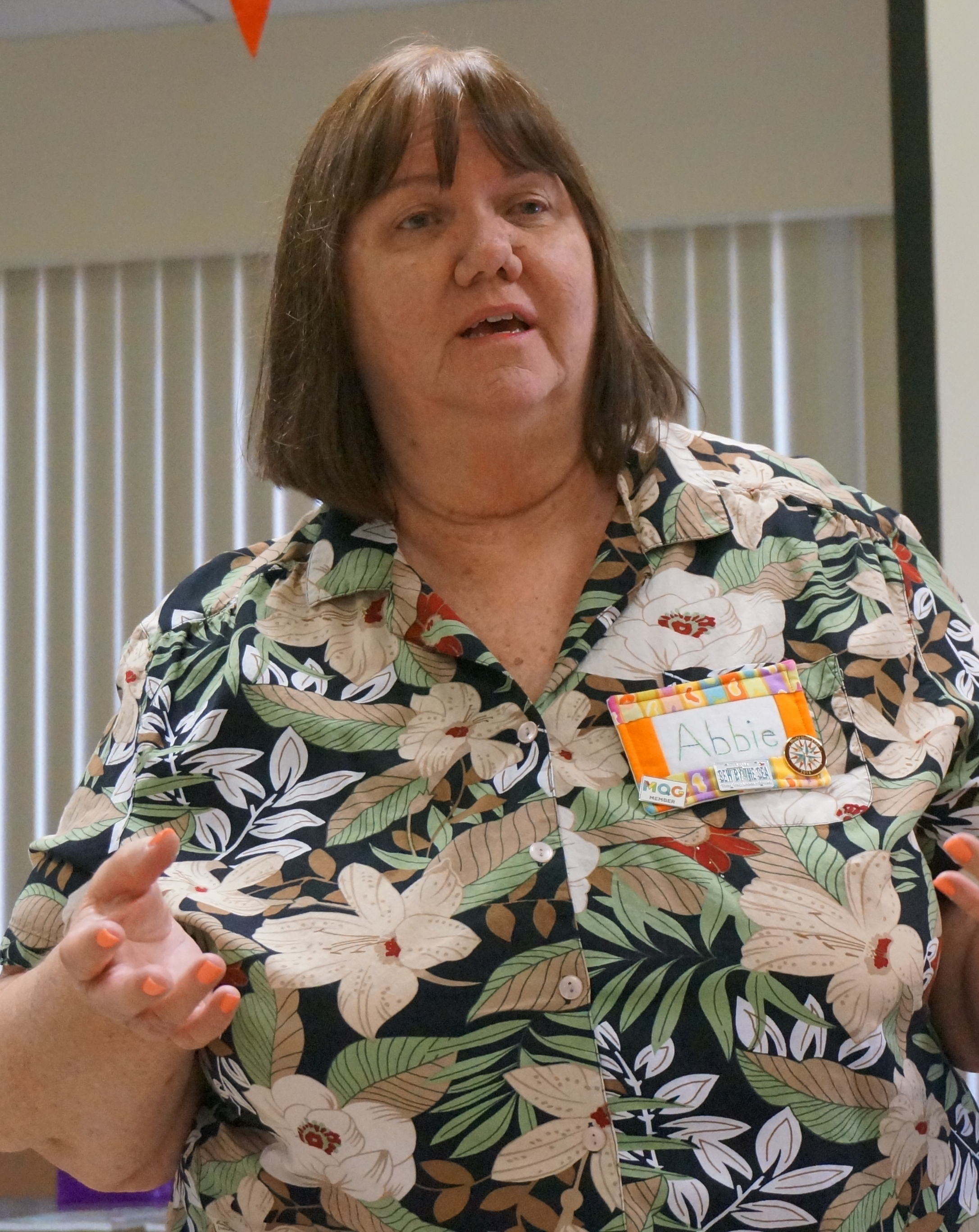 Outgoing Treasurer Abbie Bill makes an introduction