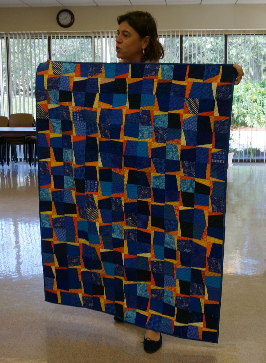 Isabella Elias and her completed BOM quilt