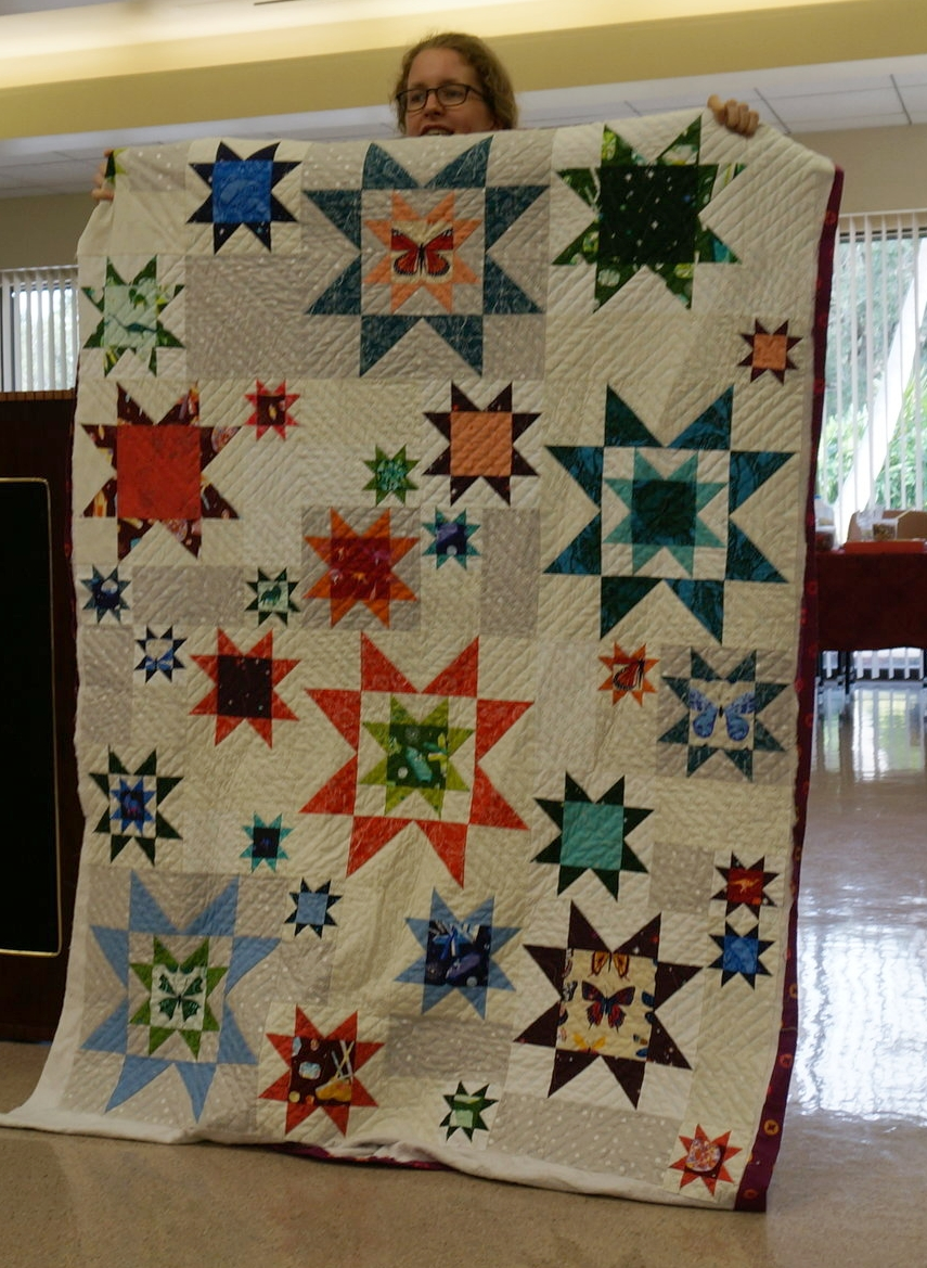 Guest Alaine Blessman shows off her star quilt.