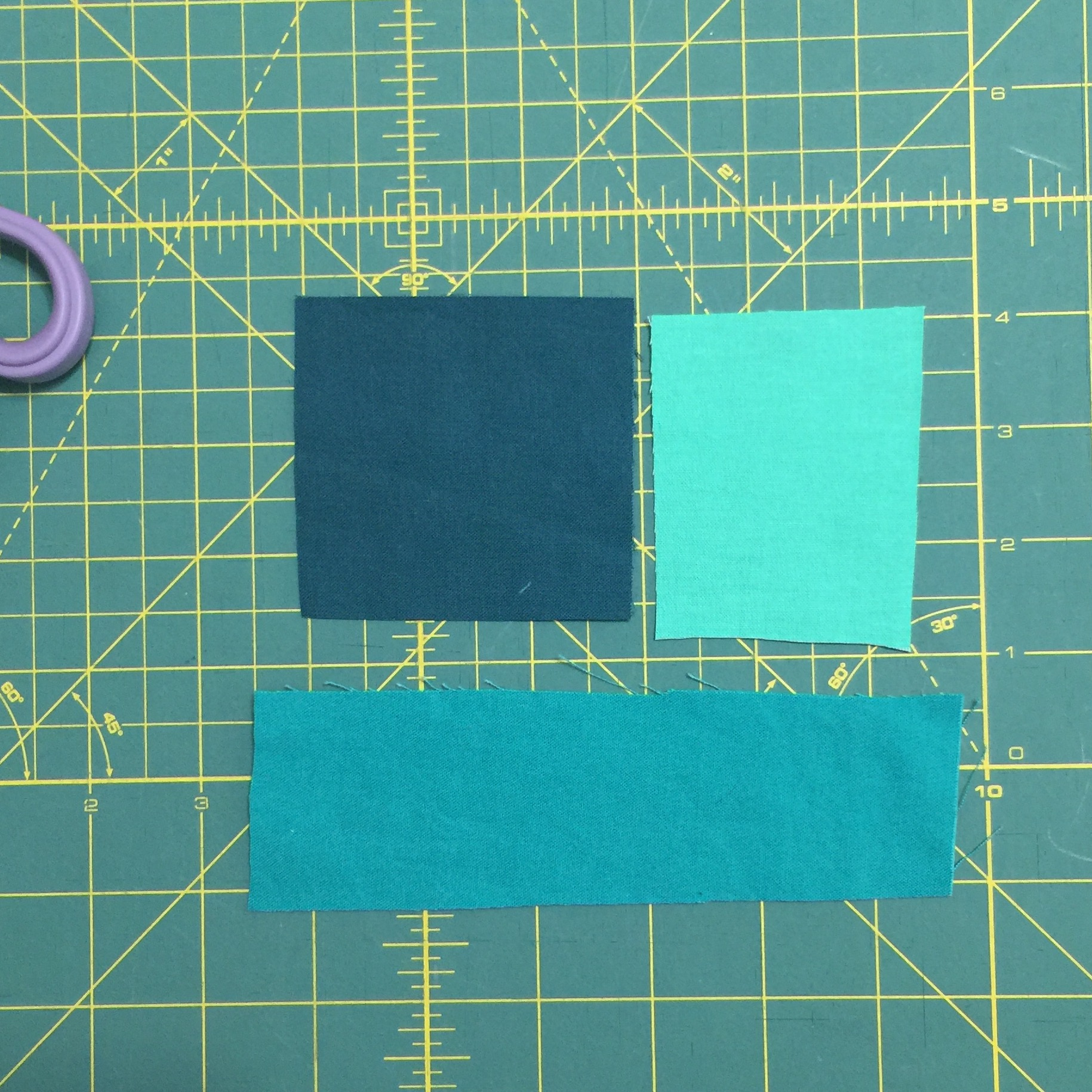 Piece your color scraps together into a rectangle shape.