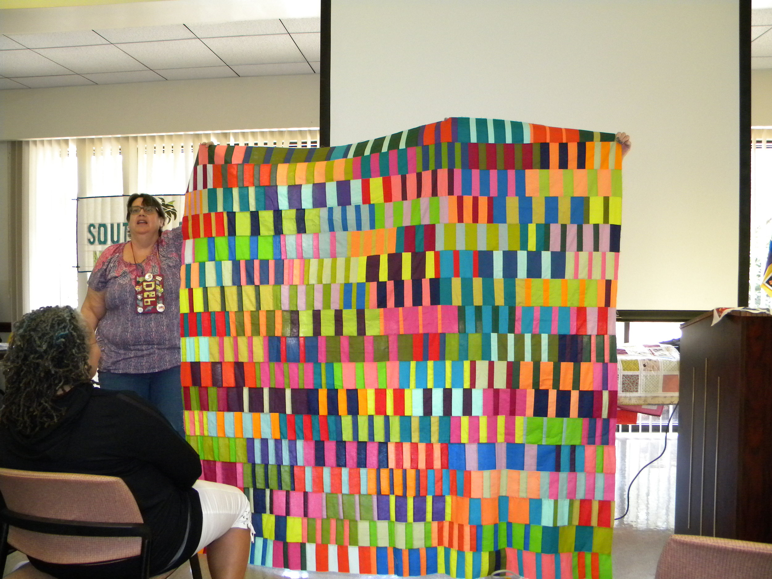 Debbie K and her top, started in the Tara Faugnan class at QuiltCon