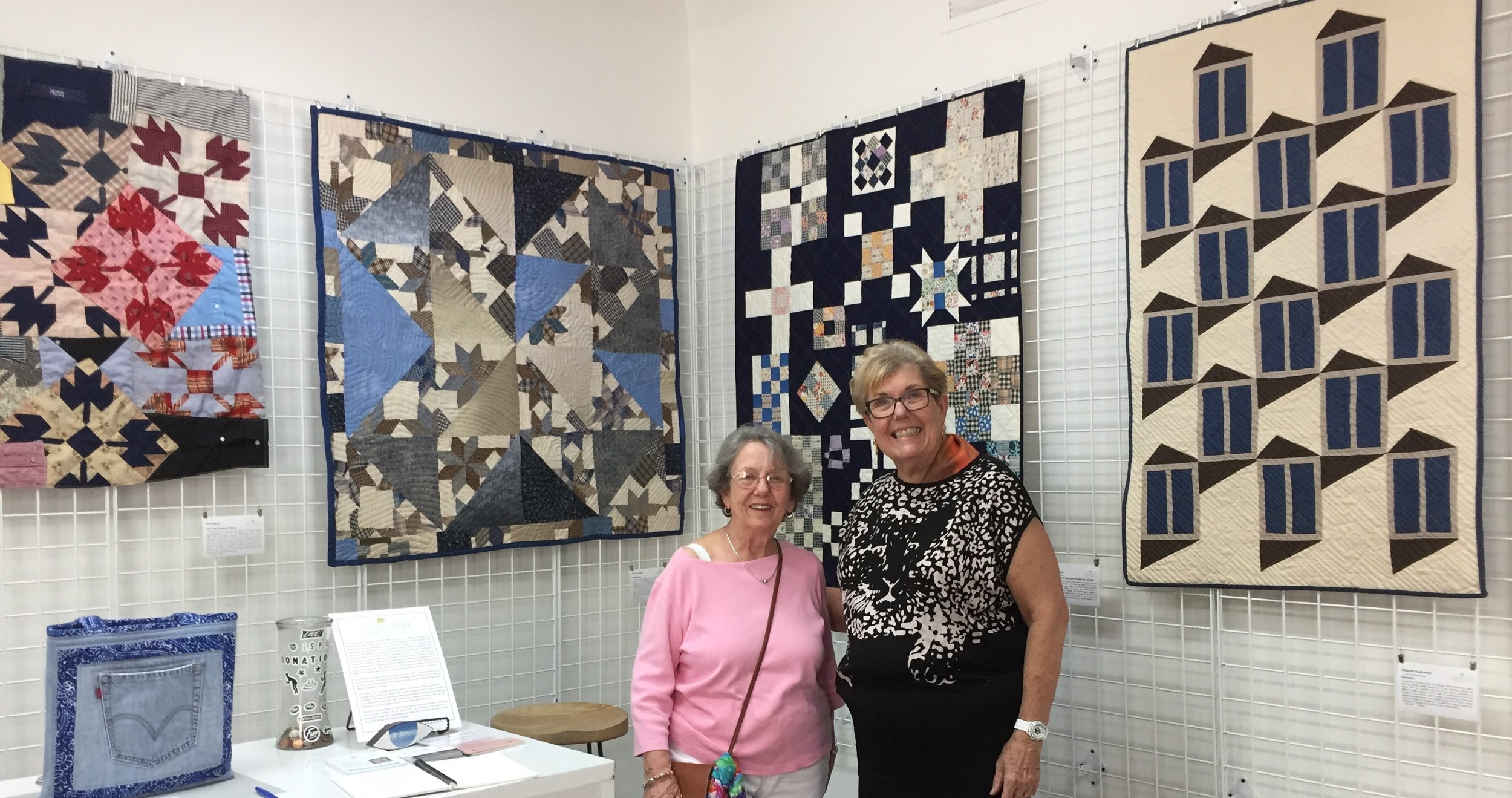 Artist Diane Moss (on right) and Guest   100 Years Between Shirts  by Diane Moss   Wondering  by Patricia Auten   Nine Patch and Navy and Feedsacks, Oh My!  by Nicole Kaplan   Fenestra  by Deborah Krajkowski   Levi Pockets Tote  by Pam Chamberlin