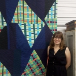 Kate Yates  VP of Events  Kate started quilting just 4 years ago. She comes from a family of quilters and sewists, and was inspired at a young age by her grandmother's quilts (and teeny, tiny stitches!). Kate is drawn to more modern designs, and loves improvisational designs and quilting. Her favorite part of quilting is design and working with her hands - she loves handwork, including hand-quilting and needle-turn applique. She found SFMQG just a couple of months after she started quilting, and has enjoyed being involved with this group, and getting to know so many like-minded quilters. When she isn't quilting, Kate is either teaching, coaching, or working on DIY projects around the house.