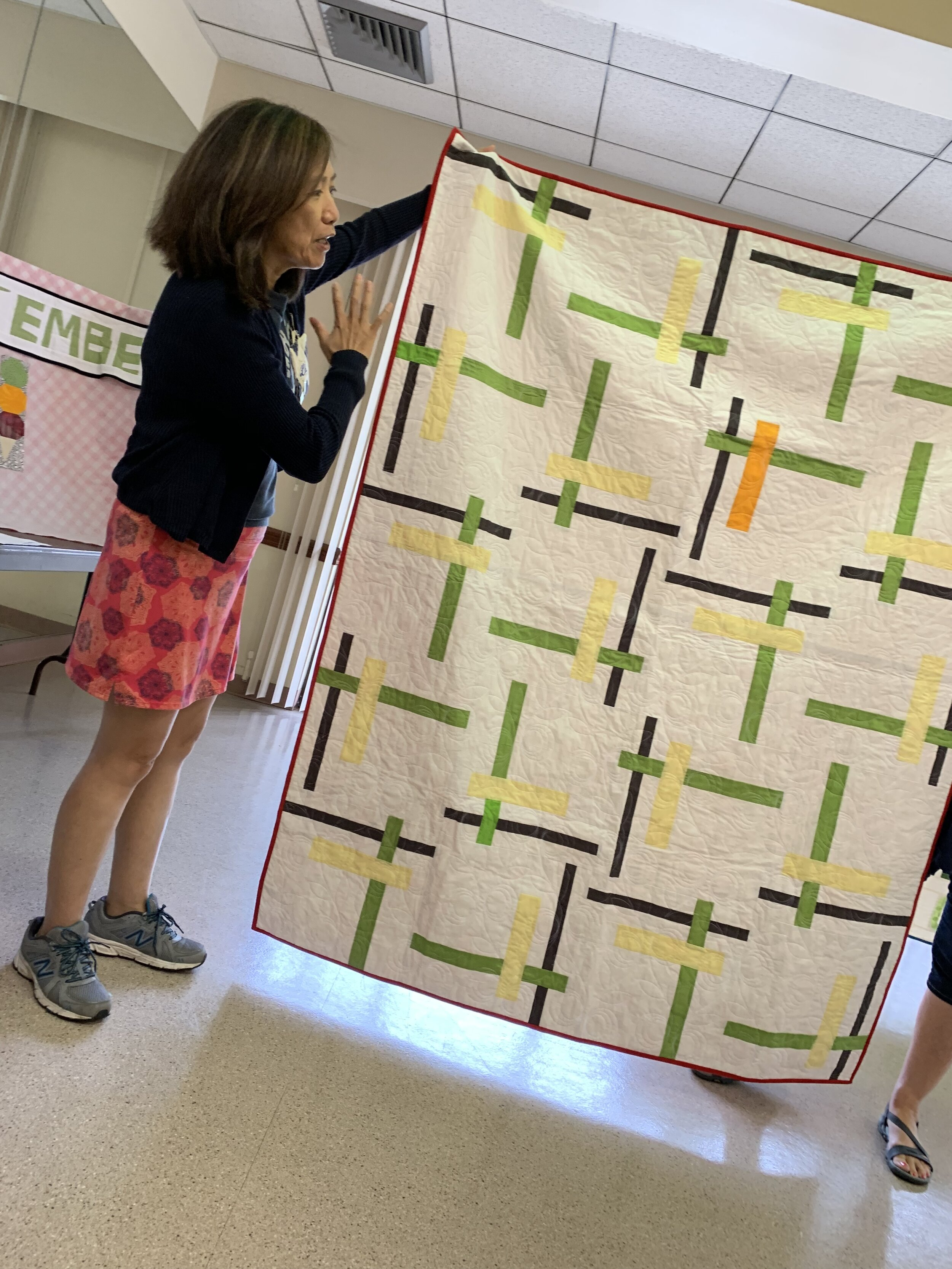 Li discussed what longarmers do and how to prepare your quilts.