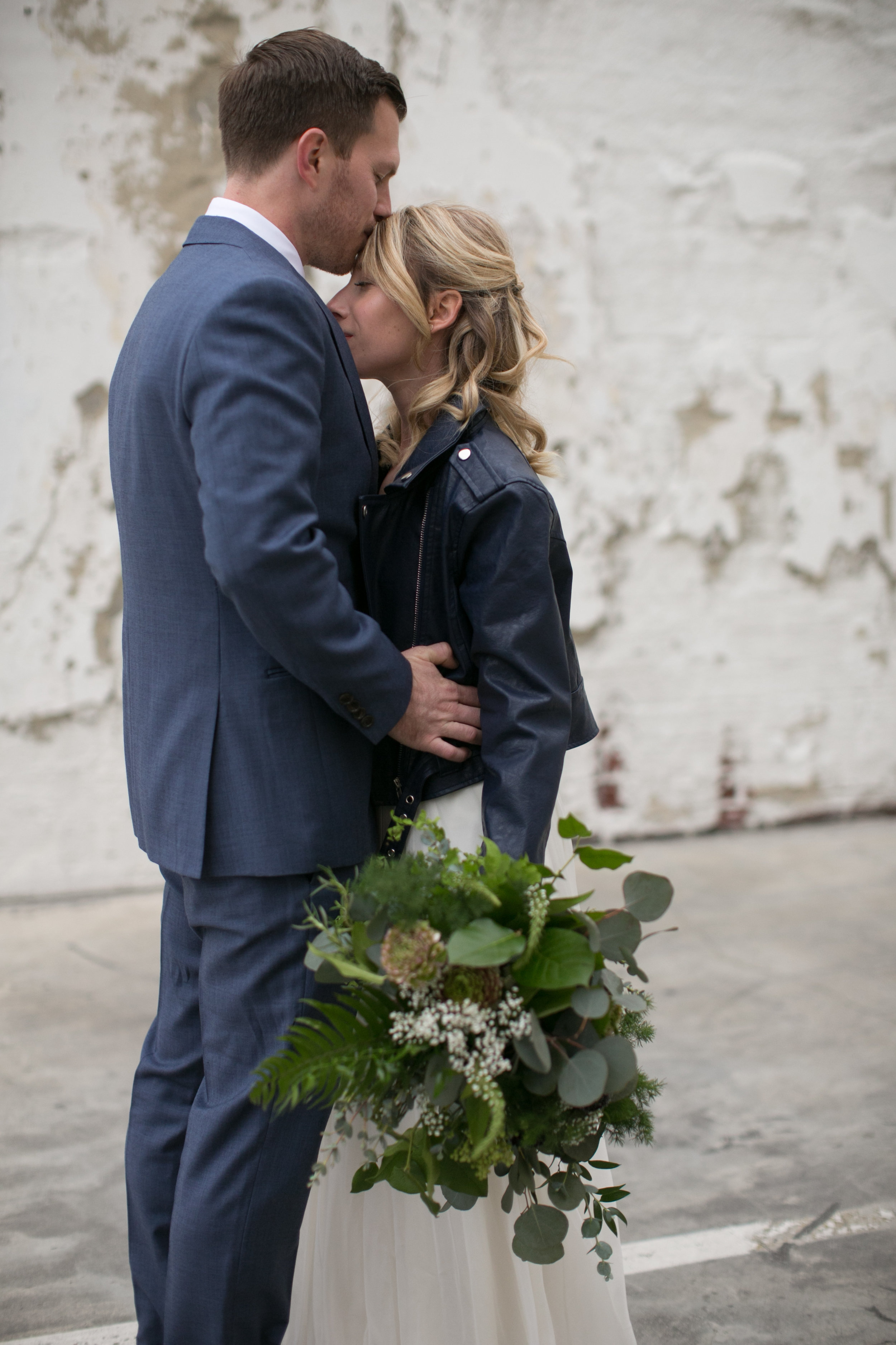 Bride and groom had a stunning navy and green winter wedding at The Loft On Pine in Long Beach, CA. The pops of rich colors matched the venues industrial vibe and the bride's giant bouquet of wild greens was pretty epic. The flowy BHLDN two piece paired with a leather jacket was perfect for the cooler weather but also looked pretty badass. Planning:@janealexandraevents Venue:@theloftonpine #JAE #longbeachweddingvenue #weddingplanning #theloftonpine #winterweddingideas
