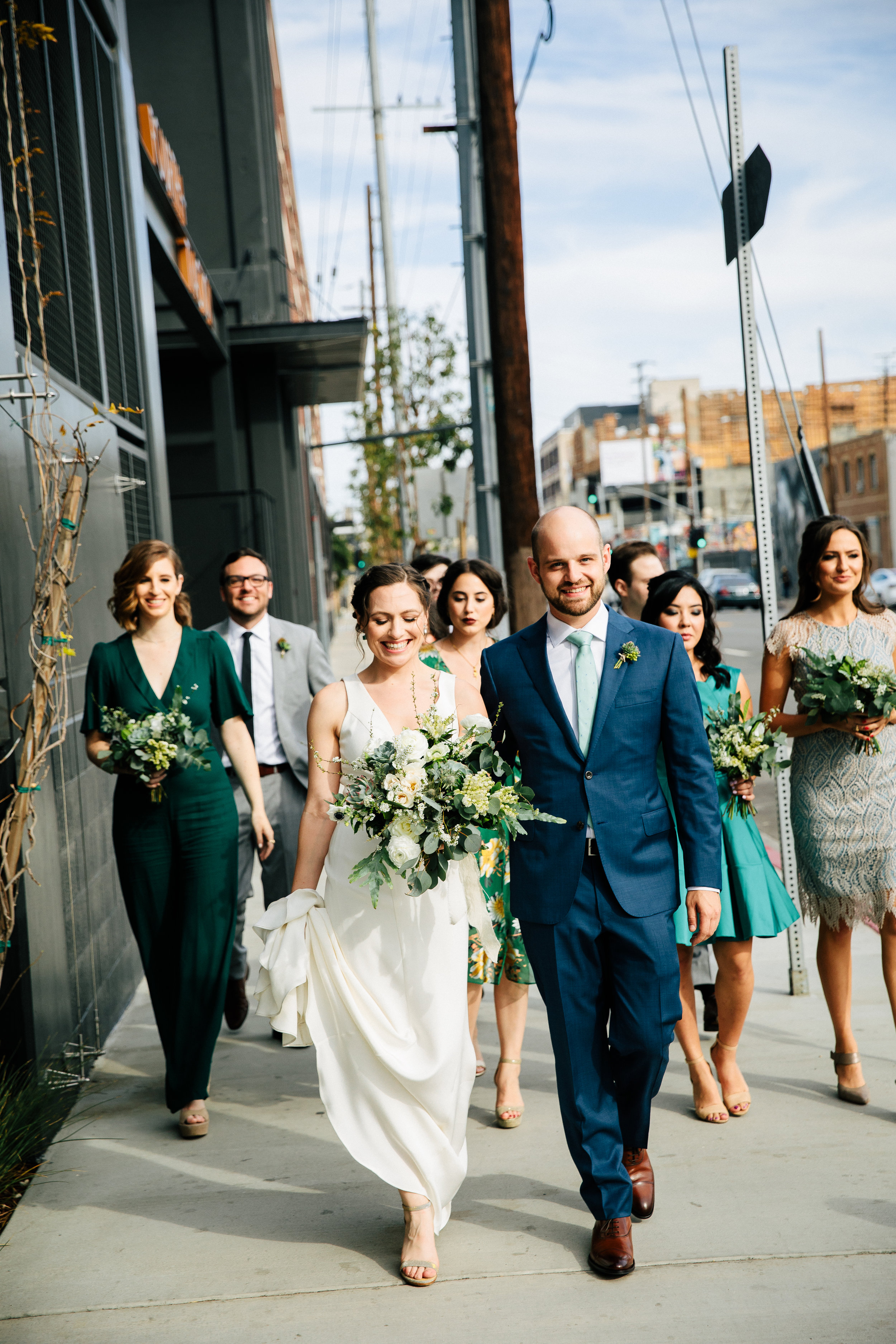 This DTLA wedding was inspired by Earth Day, it's vibe was natural and minimal. The color palate is blue, green, rusty pinks and oranges. The LA bride had a custom wedding gown that was simply elegant. Rental furniture with velvet, wood matched the industrial #greenhouse of Millwick Wedding Venue in Los Angeles, CA. The florals were potted plants so they could be replanted post wedding. #JAE #janealexandraevents #dtlaweddingvenue #weddingplanning #losangeleswedding