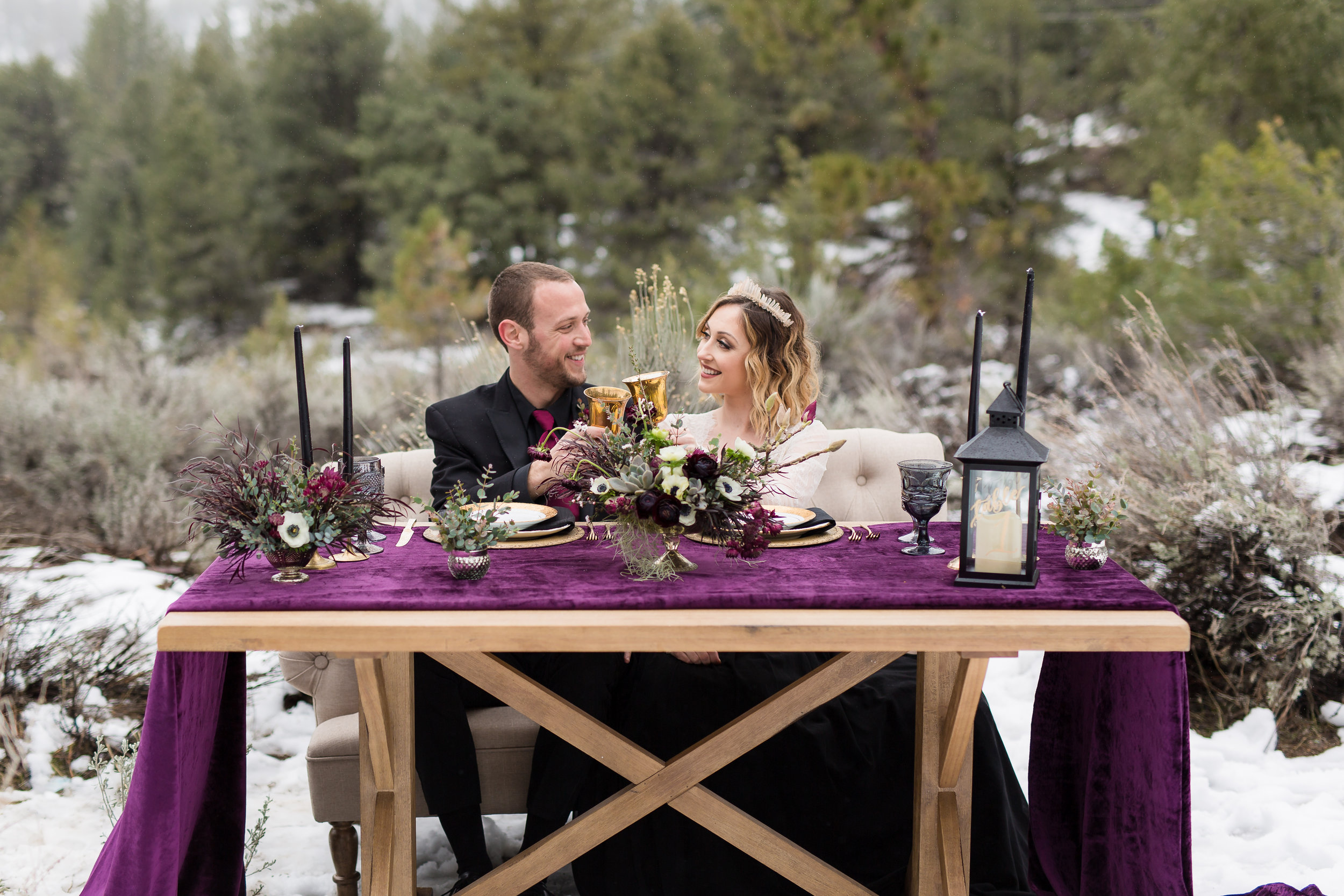 """For this moody winter styled shoot we choose colors that would pop against the white snow. Rich reds, purples, and black became the perfect palate. The beautiful bride transformed into an """"ice queen"""" with a quartz crown. The flowers fit the stunning moody and bold vibe of this wedding styled shoot in Frazier Park, CA. #JAE #janealexandraevents #mountainweddingvenue #winterweddingplanning #californiawinterwedding"""