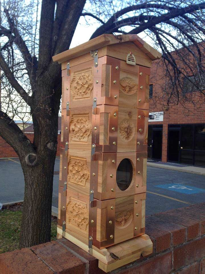 Eco Bee Box  carving of a top bar hive.