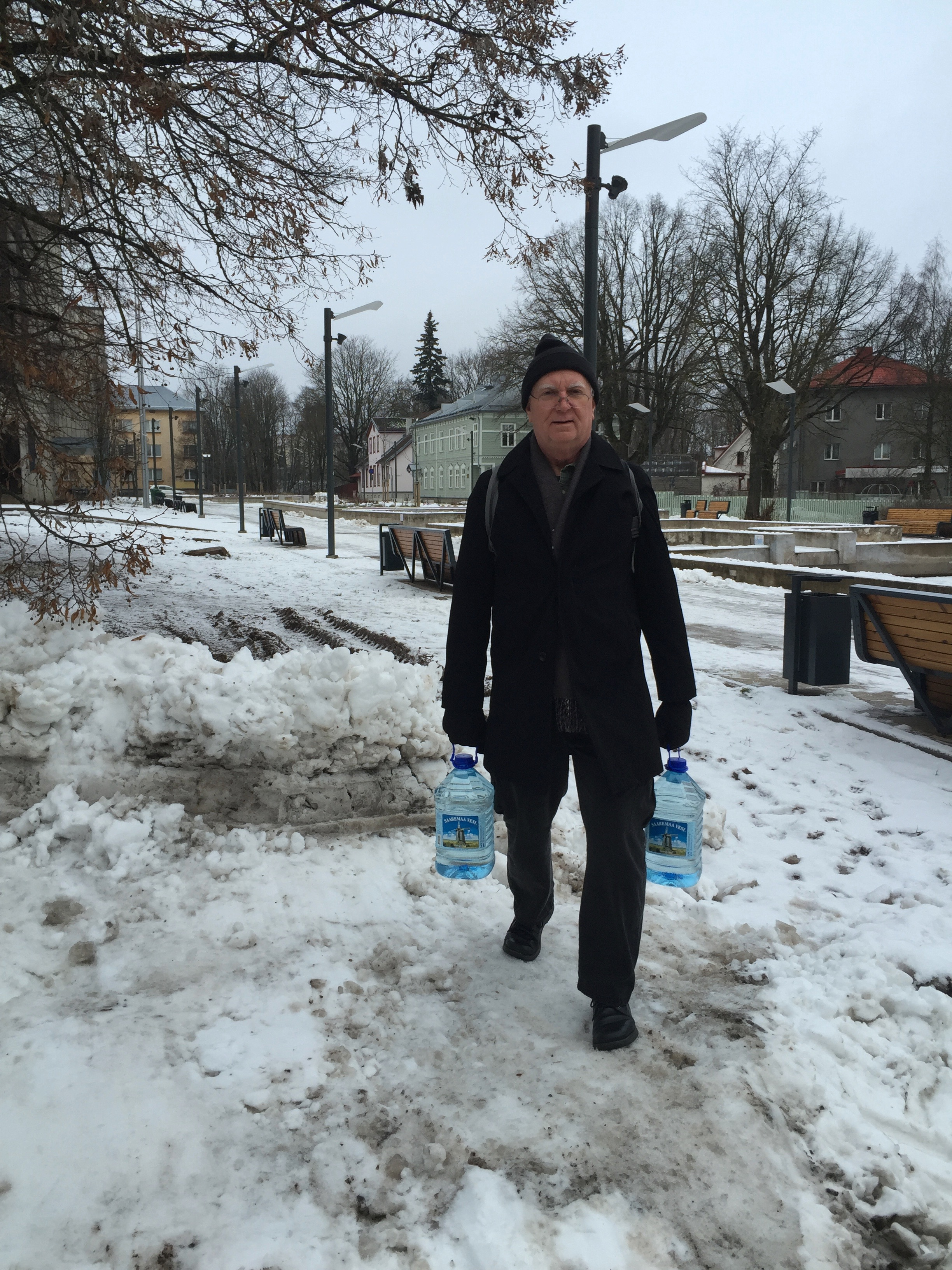 Jim carries water through the snow…..on the way to the studio….