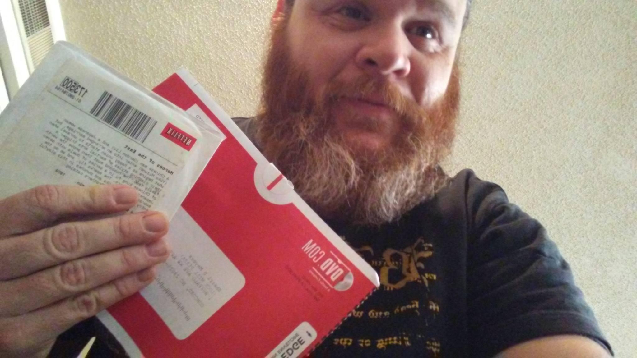 James Meyers with Netflix DVD envelopes
